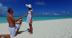 V14861 two 2 people proposal marriage romantic young couple holding hands on a tropical island of white sand beach and. Two 2 people proposal marriage romantic stock video