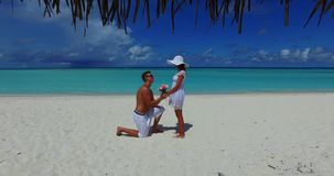 V14866 two 2 people proposal marriage romantic young couple holding hands on a tropical island of white sand beach and. Two 2 people proposal marriage romantic stock video footage