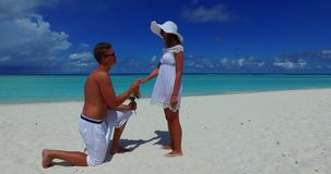 V14862 two 2 people proposal marriage romantic young couple holding hands on a tropical island of white sand beach and. Two 2 people proposal marriage romantic stock video footage