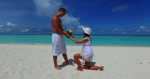 V14868 two 2 people proposal marriage romantic young couple holding hands on a tropical island of white sand beach and. Two 2 people proposal marriage romantic stock video footage