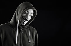 V for Vendetta or Guy Fawkes mask. Hooded man wearing V for Vendetta mask Royalty Free Stock Photos