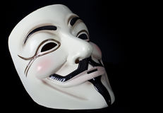 V for Vendetta or Guy Fawkes mask. Hooded man wearing V for Vendetta mask Stock Photos