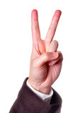 V for Victory. Hand in a suit making the Victory sign isolated in white background Royalty Free Stock Images