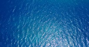 V12115 water texture breaking and crashing with drone aerial flying view of aqua blue and green clear sea ocean metrajes