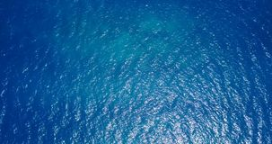 V12115 water texture breaking and crashing with drone aerial flying view of aqua blue and green clear sea ocean Fotografía de archivo