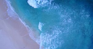 V11190 waves water texture breaking and crashing with drone aerial flying view of aqua blue and green clear sea ocean. Waves water texture breaking and crashing Royalty Free Stock Photo