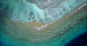 V12201 waves water texture breaking and crashing with drone aerial flying view of aqua blue and green clear sea ocean Royalty Free Stock Image