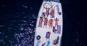 Free V09150 Group Young Beautiful Girls Sunbathing On A Boat With Aerial View In Clear Aqua Blue Sea Water And Blue Sky Royalty Free Stock Photos - 103551968