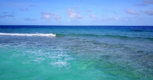Free V13210 Waves Water Texture Breaking And Crashing With Drone Aerial Flying View Of Aqua Blue And Green Clear Sea Ocean Stock Photos - 103494923