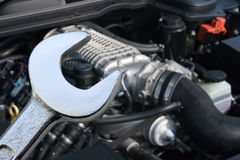 V8 Supercharged car engine and spanner. With focus on the spanner Stock Image