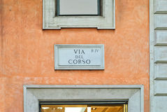 Vía del Corso, placa de la calle en una pared en Roma, Italia Fotos de archivo libres de regalías