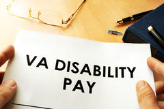 VA Disability Pay policy. Veterans Compensation Benefits concept Stock Photos