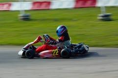 Va el competir con del kart Fotografía de archivo