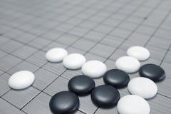 Va il gioco o il gioco da tavolo di cinese di Weiqi Fotografia Stock Libera da Diritti