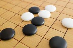 Va il gioco o il gioco da tavolo di cinese di Weiqi Fotografie Stock Libere da Diritti