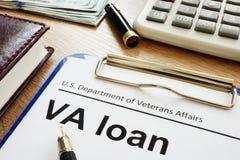 VA loan U.S. Department of Veterans Affairs form with clipboard. VA loan of U.S. Department of Veterans Affairs form with clipboard royalty free stock images