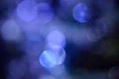 Vaag, bokeh lichtenachtergrond. Abstracte fonkelingen Stock Afbeeldingen