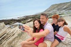 Vacaciones de familia en la playa Foto de archivo