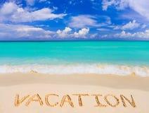 Vacaciones de la palabra en la playa fotografía de archivo
