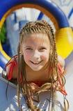 Vacaciones Muchacha feliz en el carrusel en el parque al aire libre Fotografía de archivo libre de regalías
