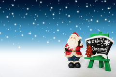 Vacances de décoration de Noël avec Santa Claus et le bonhomme de neige sur le sno Images libres de droits