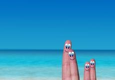 Vacances de paradis de la famille des doigts Photo libre de droits