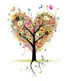 Vacances heureuses, arbre de forme de coeur avec des ballons Photographie stock