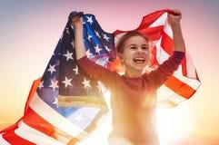 Vacances patriotiques et enfant heureux Images stock
