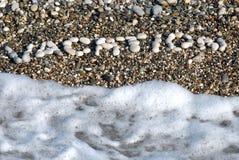 Vacances Pebbly d'inscription Photos stock