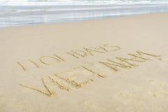 Vacances Vietnam écrit en sable Photographie stock