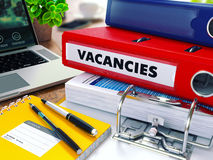 Vacancies on Red Ring Binder. Blurred, Toned Image Stock Photography