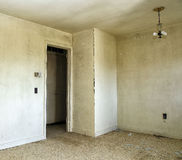Vacancy. Image of an old house interior with a hanging light and open doorway Stock Photo
