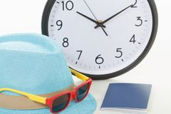 Vacancy concept. Clock, passport and sunglasses. On hipster hat stock image