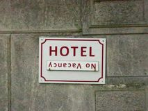 Vacancy sign on the wall of an old hotel. A vacancy sign on the wall of an old hotel royalty free stock images