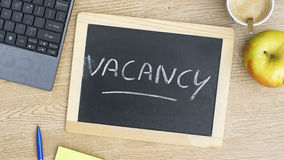 Vacancy written. On a chalkboarde at the office royalty free stock photo