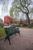 Vacant bench in King's Garden, Stockholm, Sweden Royalty Free Stock Photo
