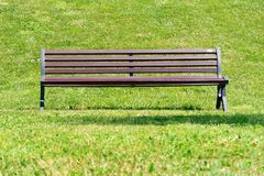 Vacant bench park frontal view. Vacant bench in the park frontal view royalty free stock image