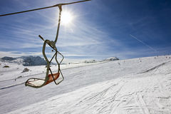Vacant chair of a ski-lift Stock Photo