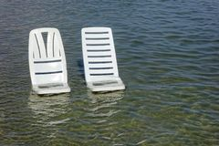 Vacant chairs the sea. Vacant chairs in the sea Royalty Free Stock Photo