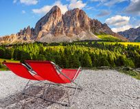 Vacant deckchairs enjoying the mountain panorama view. At summer stock image