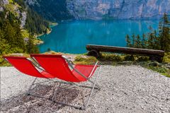 Vacant deckchairs mountain lake at summer relaxing view stock image