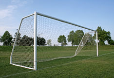 Vacant Goal. A vacant soccer goal on a pitch with a blue sky Royalty Free Stock Photography