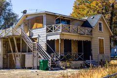 Vacant Home Lost To Foreclosure. Vacant Home With Boarded Up Windows & Doors royalty free stock photos