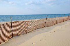 Vacant Lake Michigan beach. Wooden fence on a vacant Lake Michigan beach in autumn Stock Images