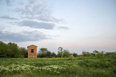 Vacant land. With a unfinished building,during the evening Royalty Free Stock Photos