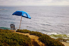 Vacant Lifeguard Post. Lifeguard absent in his post with a view to the ocean from a cliff royalty free stock images