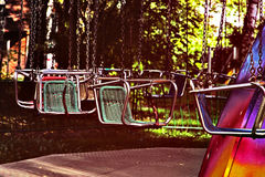 Vacant merry-go-round seats taken closeup. Royalty Free Stock Photo