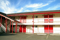 Vacant motel. Exterior parking lot view of an empty motel Royalty Free Stock Photography