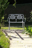 Vacant public bench in the garden Royalty Free Stock Images