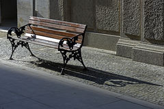 Vacant public bench in the street Royalty Free Stock Photos